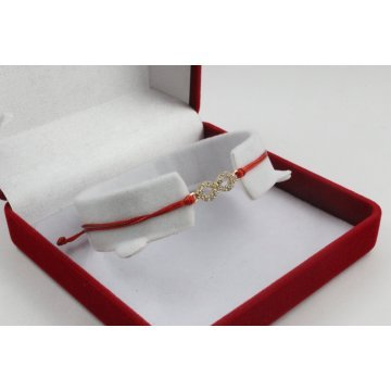 Златна регулираща се гривна с червен конец и златна безкрайност с камъни 2715